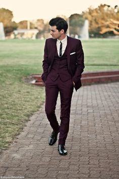 a plum suit as worn by mafioso worldwide can also be pulled off with class. *ehem*. not to say mafia arent classy. (the curator not a fan of concrete shoes)