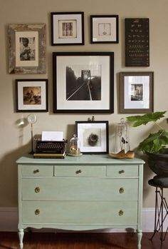 Lovely light green dresser with gallery wall.