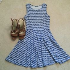 Blue Chevron Dress You are looking at a cotton, blue chevron summer dress. I love to pair this dress with heels or jack rogers, but now it's too short for me, and I sadly have to let it go. Selling the dress only. Soprano Dresses