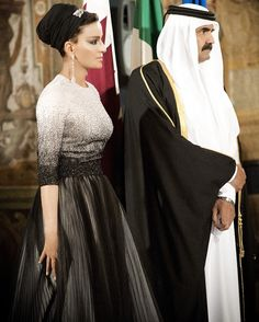 Sheikha Mozah & Sheikh Hamad at the Italian State Visit banquet in Rome in 2012. Sheikha looks absolutely divine in black and white beaded Dior couture gown from the Fall 2012 collection. Stunning diamond earrings and brooch on the turban completed...