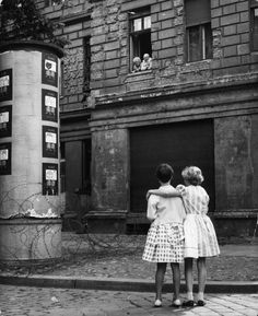 West German girls chat with their grandparents in East Germany, separated from them by an early version of the Berlin Wall.How terribly tragic - families separated by the Berlin Wall. Ddr Und Brd, Portraits Victoriens, Berlin Hauptstadt, Ddr Museum, The Last Summer, Historia Universal, East Germany, Berlin Germany, German Girls