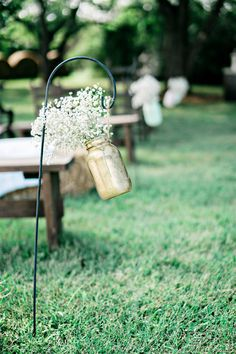 Simple ceremony aisle markers - gold-painted mason jars with baby's breath {Andie Freeman Photography}