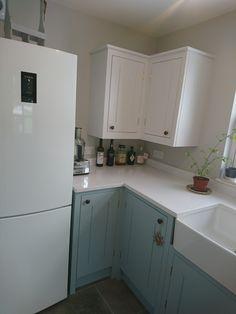 British Standard kitchen. Bottom cupboards painted in Little Greene Celestial Blue. Top cupboards painted in Little Greene Bone China Blue Pale.