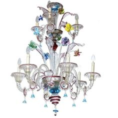 Exquisite Italian Glass Chandelier ($9,980) ❤ liked on Polyvore featuring home, lighting, ceiling lights, chandeliers, clear, hanging island lights, glass flower chandelier, flower chandelier, murano glass lamp and colorful chandelier