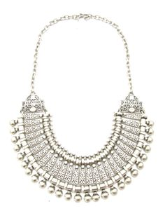 Petra -   Regal silver plated Turkish coin chest plate. This is a statement boho luxe tribal inspired piece.  Necklace features adjustable chain. Can be worn high on the neck as a choker or on the chest above the bust.