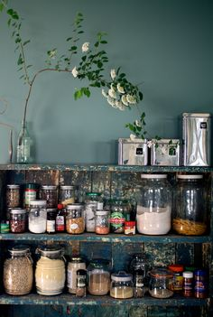 store pantry items in recycled glass jars. bye-bye cardboard boxes. this is much prettier. can use chalkboard paint for lids or make labels