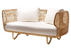 For sunrooms, screened porches, and covered spaces only: Nest Sofa from Danish designers Foersom & Hiort-Lorenzen. Made of sustainable rattan,