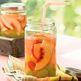 1 cup peach schnapps ½ cup frozen lemonade concentrate, thawed 2 nectarines, sliced 1 cup green or red grapes, whole or sliced  Instructions...