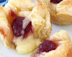 Flaky puff pastry, creamy brie and tart cranberries—that's all you need to pull together these fancy appetizers. We guarantee no one will believe you when you tell them how easy they are to make. Fancy Appetizers, Thanksgiving Appetizers, Holiday Appetizers, Thanksgiving Recipes, Appetizer Recipes, Holiday Parties, Holiday Foods, Holiday Ideas, Brie Bites