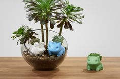 Ceramic monsters have a nice heft with a smooth, shiny shell. The planters do NOT come with a plant. We unfortunately are having troubles with getting plants, so we are just selling the pots for now.