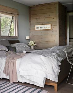 Peaceful bedroom - a bit minimalist, but with softer textures. From House Beautiful.