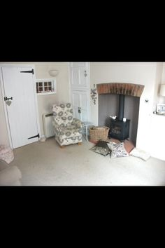 Log burner with bricks like ours at the top Alcove Cupboards, Brick Arch, Room Ideas, Decor Ideas, Terraced House, Front Rooms, Log Burner, Uk Homes, Lounge Ideas
