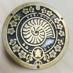 Japanese Manhole Cover Belt Buckle, Nautilus Style. $85. Copy of a manhole cover from Mine-shi, Yamaguchi prefecture.