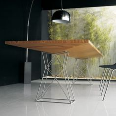 The Curzon Dining table made in Brazil for Luxo by Modloft