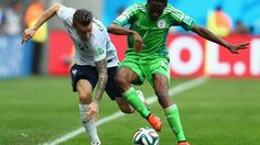 Mathieu Debuchy of France is challenged by Ahmed Musa