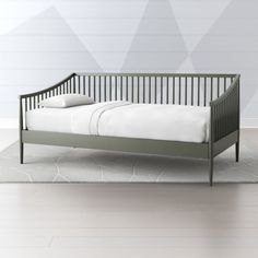 Shop Hampshire Spindle Olive Green Daybed.  Perfect for a spare kids room, spare bedroom or living room, our Hampshire White Spindle Daybed sports a clean, timeless design that plays nicely with any type of décor you have.