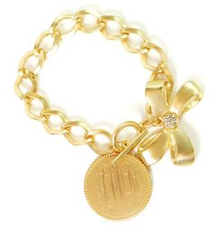 A bracelet with a bow and monogram