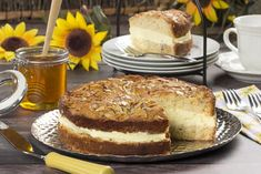 """This dessert is sure to create a lot of """"buzz"""" with your gang! Our German Bee Sting cake is based on the traditional German """"Bienenstich,"""" which is basically a honey-glazed cake with a layer of creamy vanilla custard. Baking Recipes, Cake Recipes, Dessert Recipes, Kitchen Recipes, Dessert Ideas, Food Cakes, Cupcake Cakes, Cupcakes, German Bee Sting Cake"""