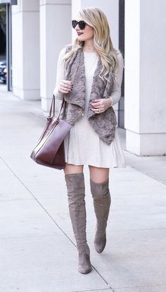 Perfect weekend errands outfit. Fur vest with knee high boots on point with a splash of Merlot from the bag.