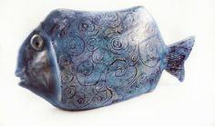 Ceramics sculpture. Ceramics fish. Clay sculpture.