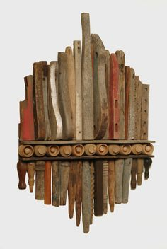 Wonderful way to arrange reclaimed pieces of wood and turn it into a work of art. #Love #art