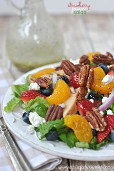 Strawberry Pecan Salad - This is a perfect springtime salad filled with fruit, nuts and more! Spice this recipe up by adding your favorite cheese and dressing!