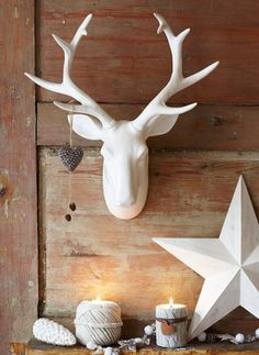 crisp white and natural wood christmas decorations with #candles