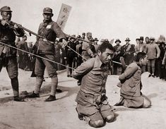 Two Chinese men kneeling prior to execution by Chinese soldiers. The Sino-Japanese war (1937-1945) was a fight against the Japanese occupation as well as a civil war between the Nationalists and Communists.