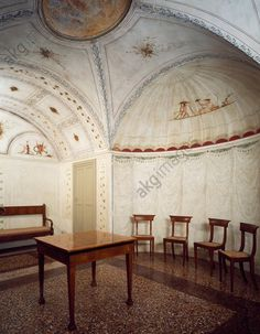 AKG-imágenes -Glimpse of a neo-classical style dining room with chairs, table and bench and decorative frescoes by Felice Giani (1758–1823), ground floor, Palazzo Milzetti, Faenza, Emilia-Romagna.