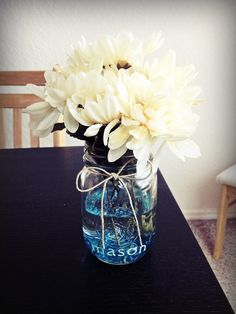"""Baby shower center piece for baby named """"Mason""""."""