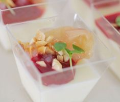 Spiced Peaches with Yogurt Panna Cotta, Raspberry Coulis, Champagne Gelée, and Basil | A super elegant dessert, this recipe tops creamy panna cotta with pink peppercorn–spiced peaches and Champagne gelée.