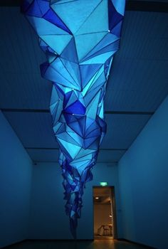 A Glowing Iceberg Made Entirely Of Staples And Tissue Paper via The Creators Project