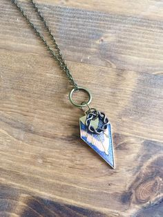 A personal favorite from my Etsy shop https://www.etsy.com/listing/258316441/arrowhead-butterfly-wing-charm-necklace
