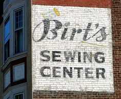 Ghost sign in downtown Indianapolis, Indiana. It's nice to see this block from yesterday has survived the city's rapid modernization.