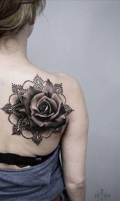 A realistic black tattoo on mandala texture.