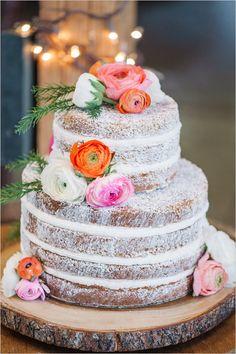 flower topped naked cake @weddingchicks