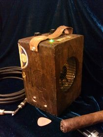 Cigar box amp you can attach a microphone to as well.  It's powered by a 9 volt battery, so you can use it anywhere!