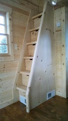 natural wood staircase for a tight space with storage drawers