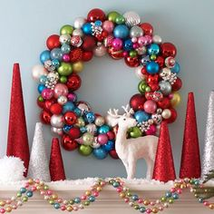 Colorful Christmas  Turn miscellaneous ornaments into a dazzling Christmas wreath. Spray-paint a foam wreath form with silver paint and let dry. Then, using hot glue, secure the largest ball ornaments to the inside and outside circles of the form, and fill in the rest of the wreath with smaller ornaments. Fill in bare spots with bunched up lengths of bead garland.