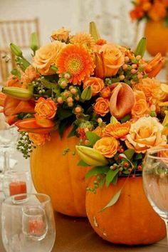 Pumpkin bouquets with blue flowers for centerpieces