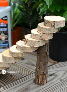 A set of wooden steps to fit the planters made using birch logs. The logs were simply cut into slices and glued together using Elmer's Pro Bond. A cut branch was used to stabilize the top of the stairs.