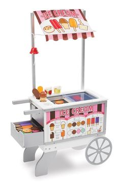 Let your little one's imagination run wild with the Melissa & Doug Snacks & Sweets Food Cart. This wooden food cart provides a variety of play scenarios: hot dog stand, ice-cream cart or mobile market with over 40 play pieces. Ice Cream Stand, Ice Cream Cart, Wooden Cart, Wooden Food, Toys For Girls, Kids Toys, Baby Girl Toys, Play Food Set, Play Sets