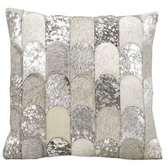 With an exquisite cowhide-and-microsuede patchwork design, this gorgeous pillow gives excellent texture to your space. The light, neutral colors keep the busy design elegant and tasteful for a truly unique piece of decor.