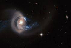 "A NEAR-COLLISION STRETCHED THIS GALAXY LIKE A ""TAFFY PULL"""