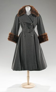 Coat Norman Norell (American, Noblesville, Indiana 1900–1972 New York) Manufacturer: Traina-Norell (American, founded 1941) Date: ca. 1955 Culture: American Medium: wool, fur Dimensions: Length at CB: 48 in. (121.9 cm)