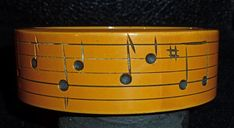 Bakelite bangle w/musical notes