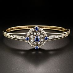 Victorian Sapphire and Diamond Circlet Bangle Bracelet. Beautifully hand crafted in the 1800s in silver over 14 karat yellow gold, 1.20 carats of impressively matched bright-blue sapphires are set like a weather vane inside double-diamond circlets. A wonderfully weighted bracelet to fit a 7 inch wrist, with the hinge on the side. Just shy of one inch wide at the largest circlet.
