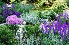 Pastel color palettes can include all hues on the color wheel in muted tones. Adding one or two plants in a more saturated color — like a dark green-leaved shrub or deep purple perennial — can keep a pastel color palette from looking washed out.