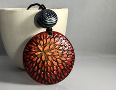 Polymer clay pendant and bead by Annie Jacobi Jewelry.