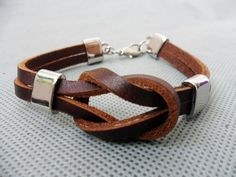 brown 2 leathers and stainless steel leather  by sevenvsxiao, $7.50